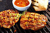 Grilled marinated collar steaks with tomato relish and white bread