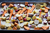 Sliced vegetables on a baking sheet