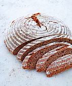 A round loaf of wholemeal bread, sliced