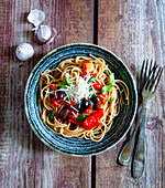 Spaghetti with a tomato and basil sacue and olives