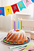 A lemon Bundt cake with candles for a birthday