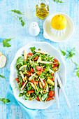 Fresh chicken salad with rocket olives cherry tomatoes and lemon