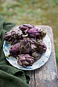 Artichokes on a plate outdoors