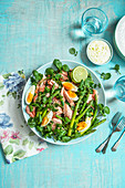 Poached salmon and watercress salad with asparagus and eggs