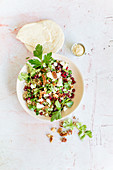 Bulgur salad with pecan nuts, pomegranate seeds and figs