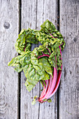 Red Swiss chard on a wooden background