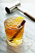 Apple cider old fashioned with cinnamon stick