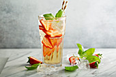 Iced green tea with strawberries and basil