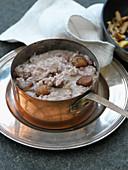 Chestnut risotto in a copper pot