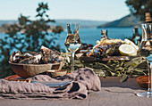 A table laid with seafood and wine by the sea