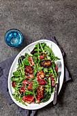 Salad with arrugula, dryed tomatoes, ham serrano