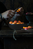 Apricots being halves and pitted