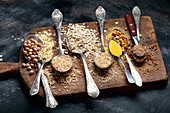 Healthy gluten free grains and flours on rustic wooden board