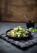 Wholemeal elbow macaroni with chard pesto, peas and leek – vegan