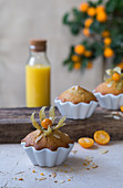 Muffins with physalis in porcelain dishes