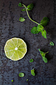 A slice of lime and mint leaves