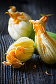 Fresh courgette flowers on a wooden table