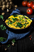 Vegetable frittata in a cast iron pan