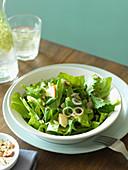 Spring salad with wild herbs, apples and hazelnuts