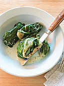 Chard rolls in a cream cheese sauce