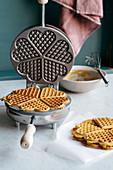 Hot pumpkin waffles in a waffle iron