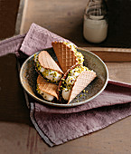 Chocolate waffles with orange ricotta and pistachio nuts