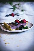 A slice of berry cherry tart