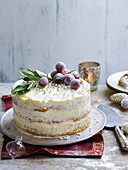 Pistachio and orange buttercream cake with candied grapes