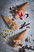 Chocolate ice cream in waffle cones with different toppings