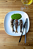 Grilled sardines with herb sauce