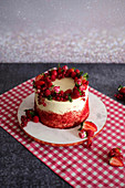 A red velvet cake with fresh berries