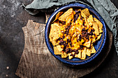 Gratinated nachos with chilli con carne and cheese