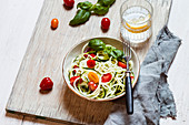 Zoodles with tomatoes and basil