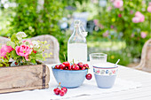Cherries and lemonade on garden table