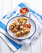 Marinated swordfish skewers with tomato cream