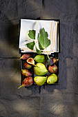 Various fresh figs in a box