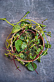 Malabar spinach in a ceramic bowl