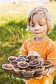Boy with cupcakes, Sweden