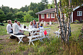 Family having meal in garden, oland, Sweden