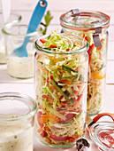 Colourful coleslaw with a mayonnaise dressing, pointed cabbage, cucumber, pepper, carrot and herbs