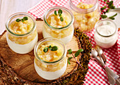 Vanilla quark cream with apple and pear compote in jars to take away