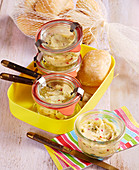 Homemade chilli butter in small preserving jars to take away