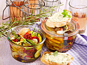 Pickled, marinated antipasti vegetables in preserving jars to take away