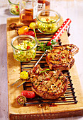 Grilled oriental marinated pork chops with a pineapple and cucumber salsa
