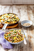 Pasta with bacon and courgette in creamy sauce