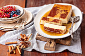 Flan with cinnamon and fresh berries