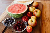 Delicious summer fruits on wooden table