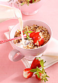 Seedy Bircher muesli with hazelnuts, strawberries and milk