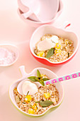 Amaranth and quinoa muesli with pineapple, mango, coconut flakes, mint and yoghurt