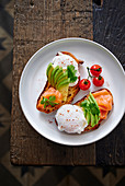 Salmon and avocado on toast with a poached egg